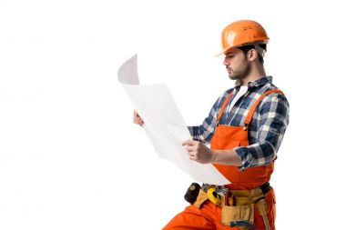 Repairman in orange overall and helmet looking at blueprint isolated on white