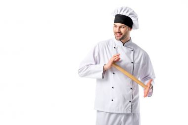 smiling chef in uniform with wooden rolling pin isolated on white