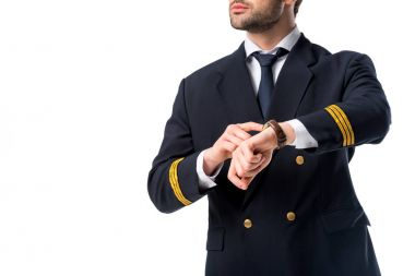 cropped shot of pilot pointing at watch on wrist isolated on white
