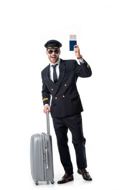 Happy pilot with luggage, passport and ticket isolated on white stock vector