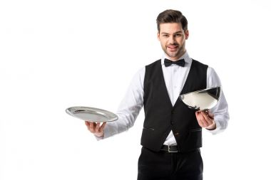 portrait of handsome bearded waiter in suit vest with empty serving tray isolated on white
