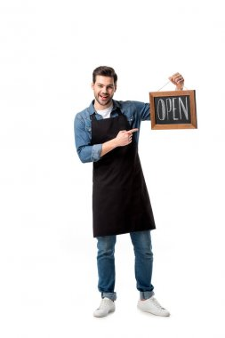 smiling waiter pointing at open blackboard in hand isolated on white