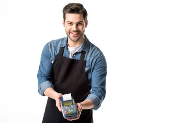 portrait of smiling waiter in apron with cardkey reader isolated on white