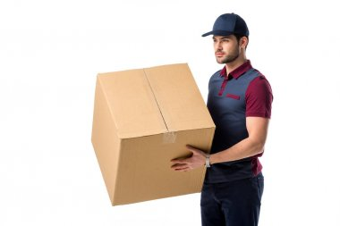 side view of delivery man in cap with cardboard box in hands isolated on white