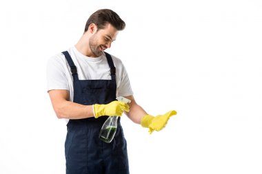 portrait of smiling cleaner in rubber gloves with detergent and rag isolated on white