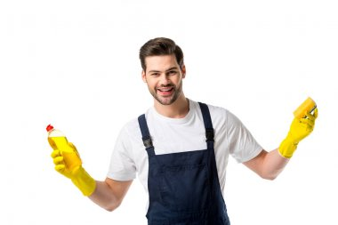 portrait of cheerful cleaner in rubber gloves with detergent and sponge isolated on white