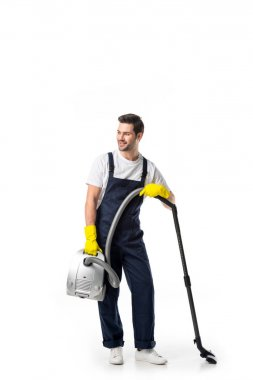 cleaner in uniform and rubber gloves with vacuum cleaner isolated on white