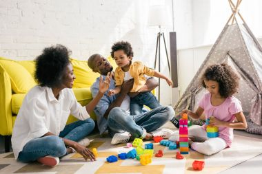 african american family spending time together at home