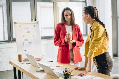 Professional business colleagues women talking in modern office
