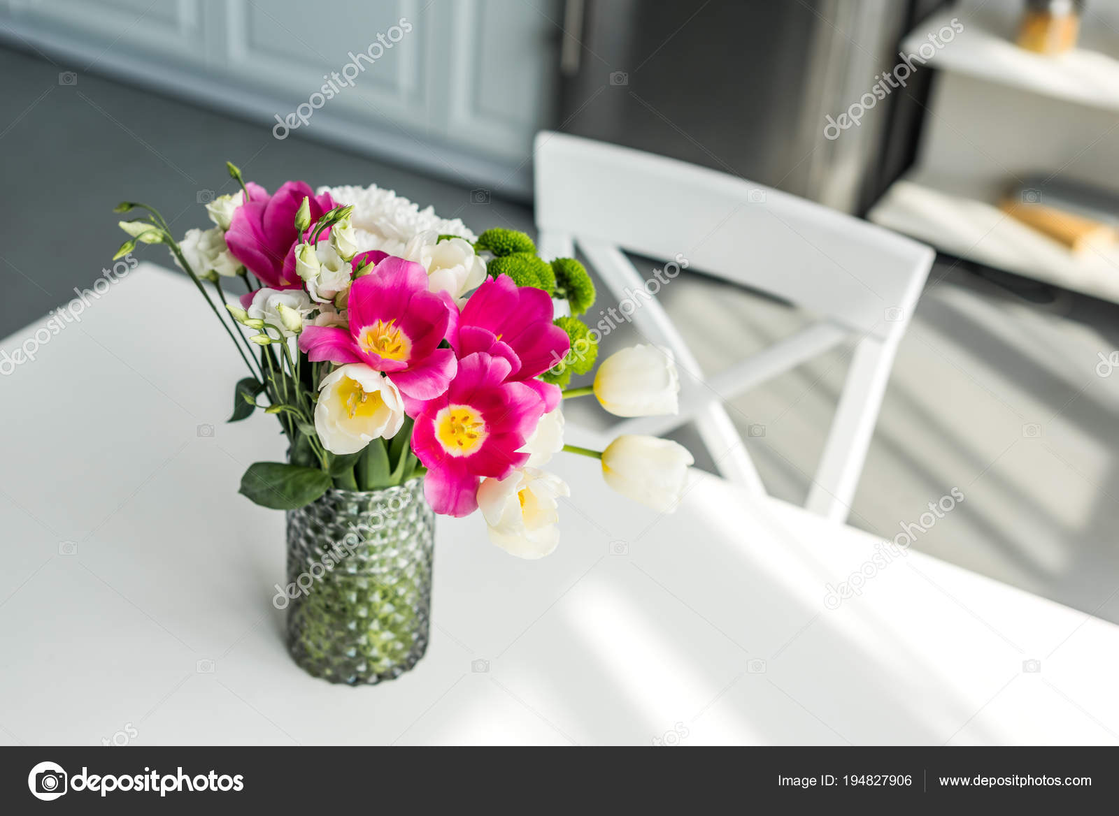 Bouquet beautiful colored flowers white table kitchen stock photo bouquet beautiful colored flowers white table kitchen stock photo mightylinksfo
