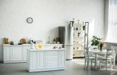 Photo interior of modern light kitchen with furniture