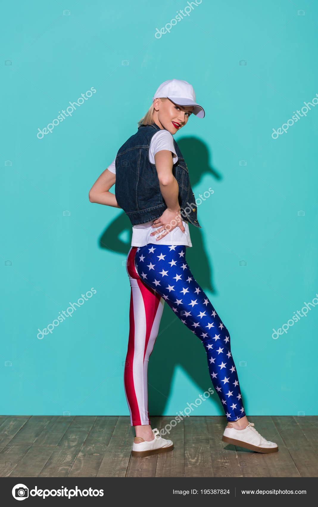 Stylish Young Woman Cap White Shirt Denim Jacket Leggings American