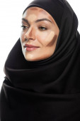 young Muslim woman in hijab with facial contouring isolated on white