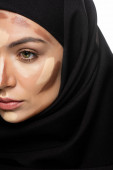 partial view of young Muslim woman in hijab with facial contouring isolated on white