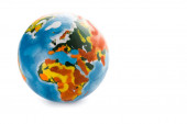 Photo colorful globe on white with copy space