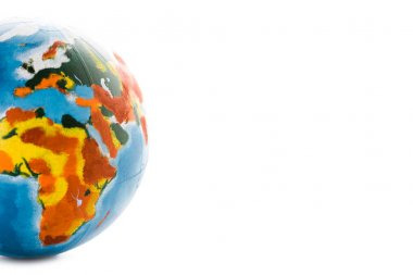 multicolored globe on white with copy space