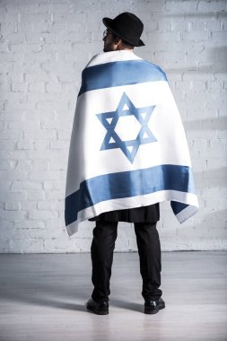 Back view of jewish man with flag of israel stock vector