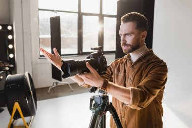 Angry photographer taking photo with digital camera on backstage stock vector