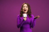 angry reporter screaming in microphone on purple background