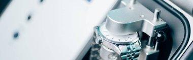 Selective focus of wristwatch in watchpress, panoramic shot stock vector