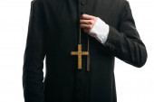 cropped view of catholic priest holding golden cross isolated on white