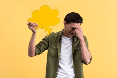 Crying man holding cloud speech bubble, isolated on yellow stock vector