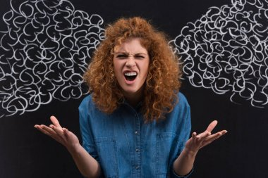 Aggressive yelling redhead girl with steam drawing on blackboard stock vector