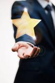 vágott kilátás üzletember öltönyben kinyújtott kézzel közel csillag fehér, minőségi koncepció