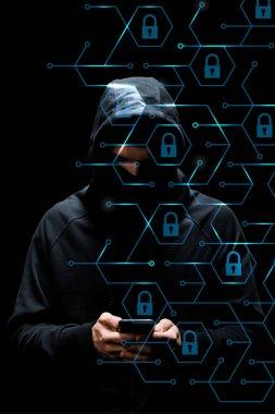 Hacker in hood using smartphone near padlocks on black, cyber security concept stock vector