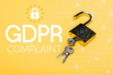 Padlock with keys near gdpr complaint lettering on yellow stock vector