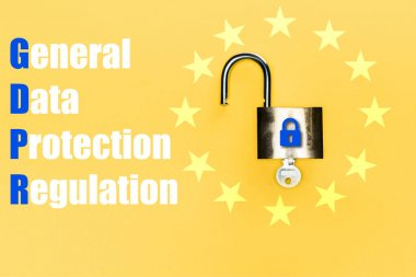 Top view of locker with key near blue gdpr lettering on yellow stock vector