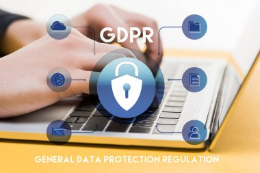 Close up of hacker using laptop near gdpr lettering on white stock vector