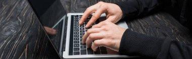 Panoramic shot of hacker typing on laptop keyboard stock vector