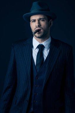 Front view of mafioso smoking cigar on dark blue stock vector