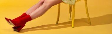 Panoramic shot of pop art girl sitting on chair stock vector