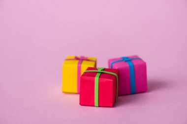 Selective focus of paper gift boxes on pink stock vector