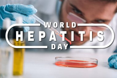 Selective focus of scientist holding pipette with red liquid in lab with world hepatitis day illustration stock vector