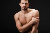 Fotografie schöner sexy nackter Mann isoliert auf schwarz