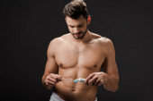 Fotografie shirtless bearded man with tooth brush and toothpaste isolated on grey