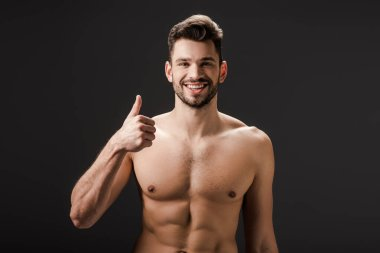 Cheerful sexy naked man showing thumb up isolated on black stock vector