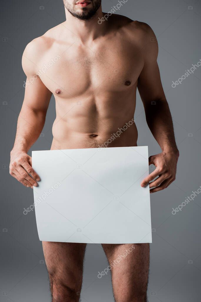Cropped view of sexy nude macho holding blank placard isolated on grey stock vector