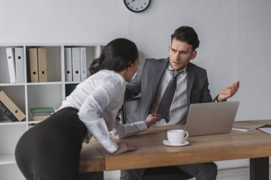 Sexy secretary touching tie of shocked businessman while seducing him in office stock vector