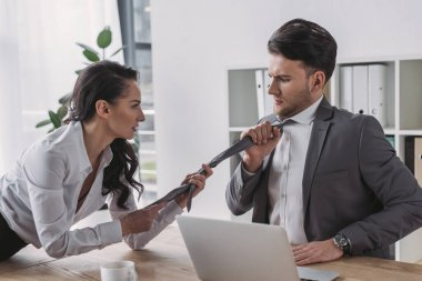 Sexy secretary touching tie of businessman while seducing him in office stock vector
