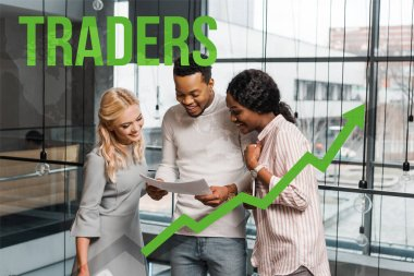smiling multicultural businesspeople looking at papers while standing in office, traders illustration