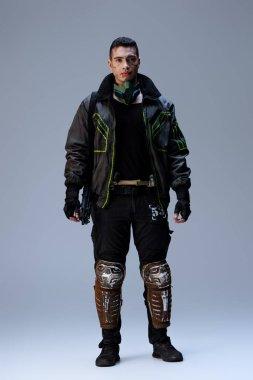 Handsome bi-racial cyberpunk player standing on grey stock vector