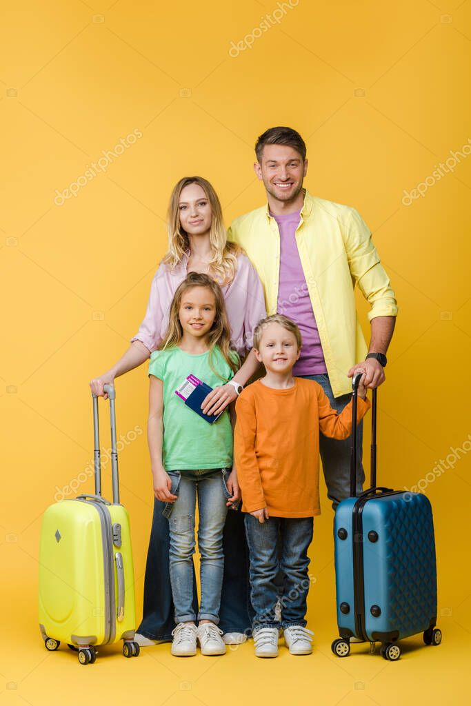 Smiling family of travelers with luggage, passports and tickets on yellow stock vector