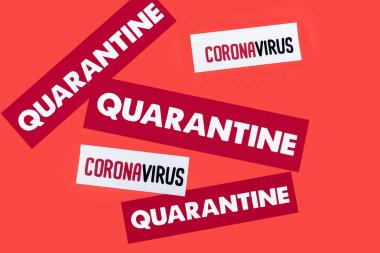 Top view of quarantine and coronavirus lettering isolated on red stock vector