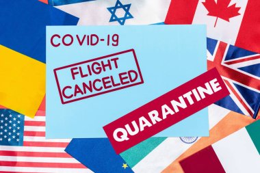Top view of blue envelope with covid-19, flight canceled and quarantine lettering on different flags stock vector