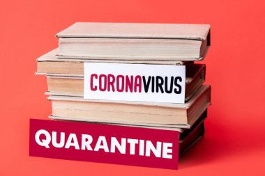 Books near cards with quarantine and coronavirus lettering on red with copy space stock vector