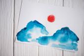 Fotografie Papier von oben mit japanischer Malerei auf Holzgrund